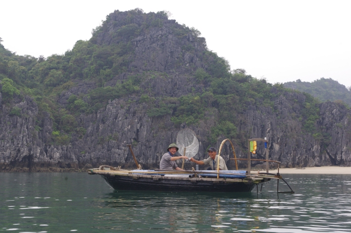 Fishermen who offered us some rice wine as we kayaked by