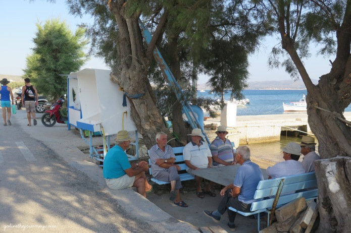 Old men chatting along the beach from Adamas